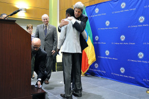 U.S. Secretary of State John Kerry hugs Boston Marathon winner Lelisa Desisa