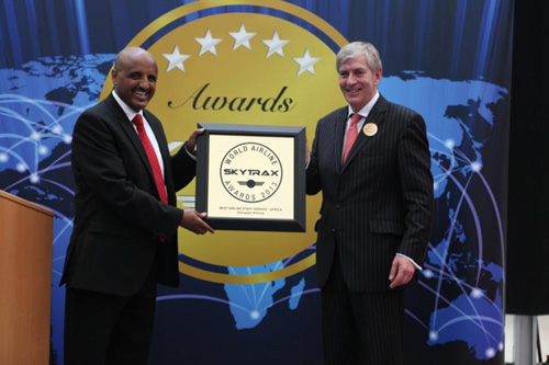 CEO Mr. Tewolde while receiving the Award