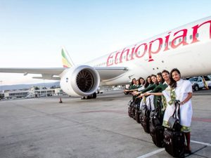 Ethiopian Airlines flight hostess posing for a photo